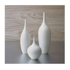 Set of 3 Modern White Small Ceramic Bottle Vases by door sarapaloma, $180.00