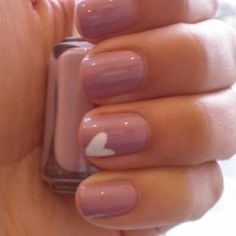 light pink nails with one white heart