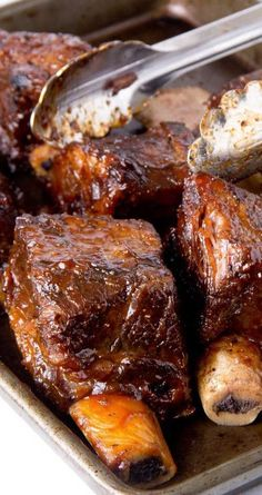 Recipe for Slow Cooker BBQ Short Ribs - These babies are so good there wont be leftovers! A little bit sweet with just the right amount of mustardy zest. If youre feeding a big crowd, double or triple the recipe. recipes for slow cooker Meat Recipes, Slow Cooker Recipes, Crockpot Recipes, Cooking Recipes, Cooking Tips, Bbq Recipes For A Crowd, Smoker Recipes, Recipies, Delicious Recipes