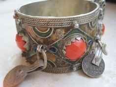 Vintage Moroccan Berber Bracelet | Silver and enamel with coins and red ceramic beads.