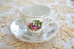 Check out this item in my Etsy shop https://www.etsy.com/listing/225125125/vintage-courting-couple-demitasse-cup