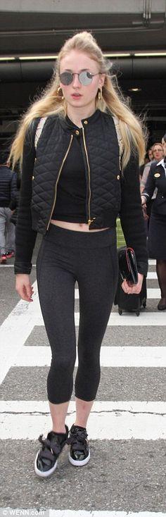 Star crossing: Sophie Turner, 20, walks through the crosswalk outside LAX on Wednesday...