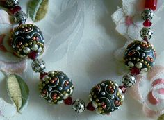 Exotic Tibeten bead necklace in red and black with siam swarovski crystals, bali silver beads and coral beads  0011/  N on Etsy, $48.00