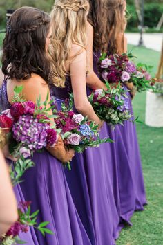 Whimsical Violet Wedding Ceremony Bridesmaid Portrait in Floorlength Jasmine Dresses with Magenta, Purple, and Tropical Greenery Bouquets Bright Purple Bridesmaid Dresses, Blue Purple Wedding, Blue And Purple Flowers, Purple Wedding Flowers, Wedding Bridesmaid Dresses, Burgundy Wedding, Bright Purple Wedding Colors, Wedding White, Wedding Gowns
