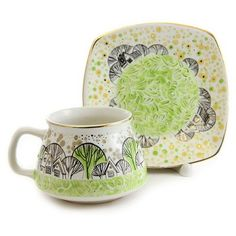 So cute, like the colors and design on the cup and saucer