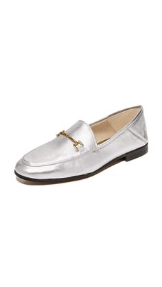 30af04e915de0d Silver leather Sam Edelman loafers masculine with flowing hardware at the  vamp.