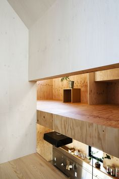"""The Japanese firm, mA-style Architects, designed this minimalist residence in Shizuoka, Shizuoka Prefecture, Japan. It was completed in 2012.                    Ant-house by mA-style Architects: """"The outer wall of black covers whole cube, and that screens visual field completely. Inside of heavy door, the space turns to vivid yellow covered by larch plywood. It seems that the world changed. It looks like hiding place. This is the house which lives married couple and their three sons. We…"""