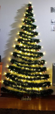 3 Affordable Winter Wall Decor Ideas - Wall decoration can be expensive, so you might want to make one yourself. Check out these three affordable winter wall decor ideas to see how. Wall Christmas Tree, Office Christmas, Noel Christmas, Simple Christmas, Christmas Lights, Christmas Crafts, Christmas Tables, Modern Christmas, Scandinavian Christmas