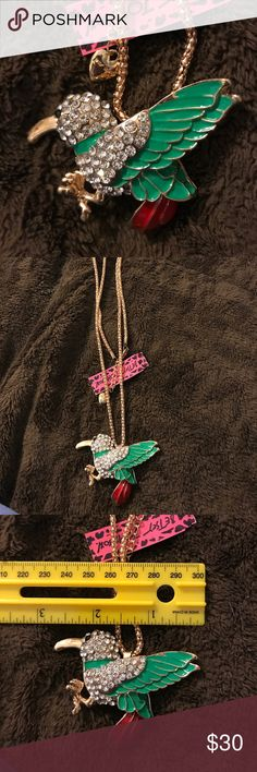 Red tail albatross rhinestone necklace Yes beautiful statement piece is green with the red tail and white rhinestones it's a beautiful statement piece Betsey Johnson Jewelry Necklaces