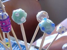 glass beads? no, they are made with fimo!