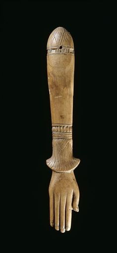 Clapper - Egyptian music instrument, shaped as hand on papyrus stem. New Kingdom  (circa 1550-1069 BC). Paris, musée du Louvre. Some Egyptian ivory sets (c. 2000 bc) are shaped like arms and hands, implying that clappers began as extensions of natural body sounds like hand clapping.
