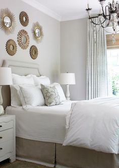 variety of round mirrors over bed