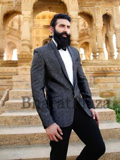 Dashing black color shawl lapel tuxedo fabricated on jacquard with two pockets and central button. Item Code: TSP2595 http://www.bharatplaza.com/new-arrivals/mens-suits.html