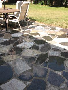 Random mixed blend flagstone look granite patio. Wet set in mortar over a concrete slab. 100% recycled granite by EcoGranite in Farmington Hills MI