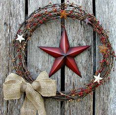 Barb wire wreath with burlap bowwith a 10 by KimsPrimitiveCrafts, $35.00