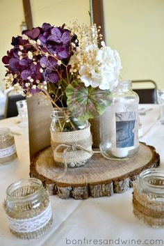 what about a picture of the two of you in 1 of the mason jars on centerpieces?? .. just thinkin... :)