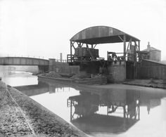 """ Loading a barge with coal from a railway wagon on the Grand Junction canal, about 1900."""
