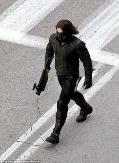 Heavily armed: The character Bucky Barnes was a friend to superhero Captain America in the first film but is brainwashed into a villain for the sequel