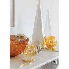 Shop soleil wire bowls.   Brass and copper bring a welcoming shine to the table or countertop.  Handmade from steel wires, simple organic shape is both refined and industrial.  Elegant displayed on a table or as a fruit bowl.