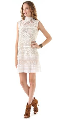 wow. love the lace and the neck line. this is $$$$ but so pretty.