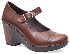 A cute new addition for Fall 2013. A classic Mary Jane with some spunk, the Dansko Fanny rides the line of saucy and sophisticated. Beautifully crafted with full-grain leathers, studded embellishments, and an adjustable ankle strap, this Dansko heel is ideal for work and play.