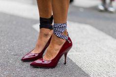 Miu Miu ribbon court shoes in patent red.