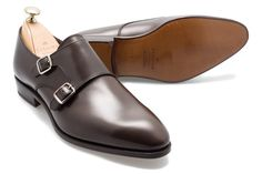 The 80281 double monk strap by Carmina sits on the tapered, almond toe Inca Last. Clean lines and a capless front balance the focus of the shoe offering an elegant take on the traditional double monk. <br />