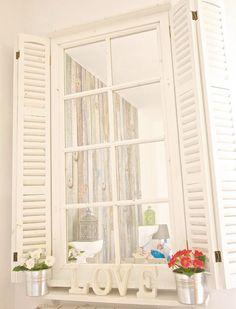 decoracion con espejos ventanal