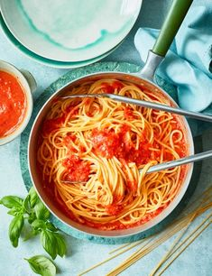 Ripe tomatoes, garlic, decent extra-virgin olive oil, fresh basil and a little black pepper is all you need to make a rich and fragrant spaghetti sauce.