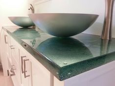 Cast glass countertops are just one stylish product to add to a contemporary bathroom. Get some fun ideas by clicking this image.