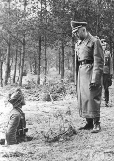 Himmler visits the training grounds and speaks with a trainee. Although ignorant of all that was military, Himmler insisted on playing field marshal and having direct control of the Waffen SS. Although he prudently remained distant from operational matters. His brief field appointment by Hitler during the closing days of the war turned out to be a predictable disaster.
