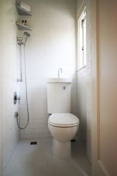 A wet bath in Portland that is 3' x 3' - so only nine square feet - and yet includes a shower, toilet, and sink, with a high shelf for extra hand towels.