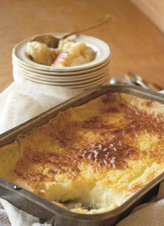 #queenm <3 Ouma Hannie's milk pudding. Serves 6 2 eggs 5 cups milk 300 ml sugar 300 ml cake flour 1 tablespoon baking powder 2 tablespoons butter 1. Preheat oven to 170 °C. Grease ovenproof a 2 litres dish. 2. Combine eggs, milk, sugar. Separate bowl, combine flour, baking powder. Add milk mixture to flour mixture little at a time. 3. Pour batter into dish, dot with butter. Bake for 30 min. 4. Turn off and leave in oven (don't open door), cool for 30-45 min. until set.