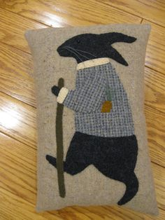 This whimsical pillow features a rabbit out for his afternoon stroll. Hes dressed in his best jacket and has his walking stick along as well. Ive