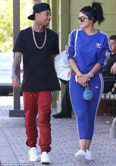 Young love: Tyga and Kylie Jenner enjoyed a romantic stroll in Calabasas on Saturday...