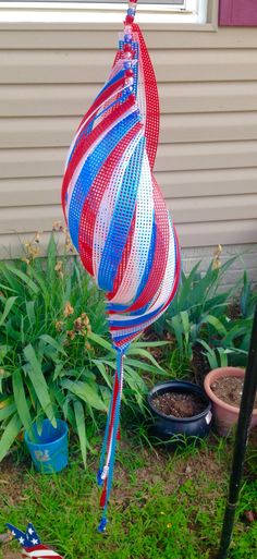 Indoor/Outdoor Patriotic Shell Shaped Wind Spinner, Red, White, and Blue USA Whirligig in Plastic Canvas and Beads available through Stitches of Light (Bottle Lights Wind Chimes) Plastic Mesh, Plastic Art, Plastic Canvas Crafts, Plastic Canvas Patterns, Garden Wind Spinners, Crochet Christmas Ornaments, Blue Garden, Whimsical Art, Greeting Cards Handmade