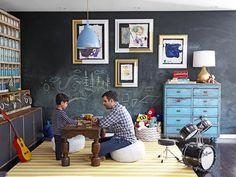children's art hangs on a wall painted in chalkboard paint in this playroom designed by Emily Henderson #hgtvmagazine http://www.hgtv.com/decorating-basics/when-emily-henderson-designs-your-home/pictures/page-4.html?soc=pinterest#