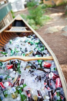 Use an old boat, canoe or kayak and fill it with ice and drinks for your family reunion #familyreunionideas #outdoorpartyideas