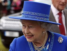 Fine fettle: The Queen looked on fine form as she watched the action at the Cartier Queen's Cup at the Guards Polo Club in Windsor Great Park