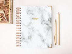SIMPLY NOTEBOOKS PLANNER ¤ Planner with marble design. Pick your favorite theme color from the drop down list. CUSTOMIZATION NB! Leave information about customization (name on the cover) in the message box at check out. If there is no information I will leave Planner 17/18 on the cover. ¤ Planner size is A5 A5 measurements are 5.8 x 8.3 in Covers are a bit larger to hide and protect the tabs. ¤ Horizontal layout: - 1 title page with contact information - 2017 & 2018 or 2018 &am...