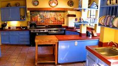 The feel of old Mexico. Stained concrete counter tops, tile mural back splash, and great Terra cotta tile floor to add to the charm.