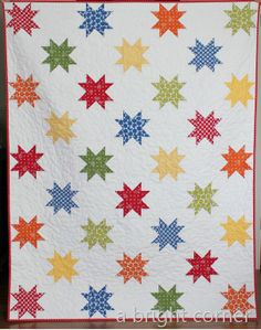 On A Roll - follow this link to a great site - called a bright corner - lots of great bright quilting ideas.  she knows how to use white spaces!