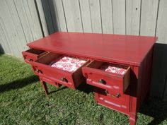This beautiful sold wood vintage desk has been listed to show as an example of one of our finishes. Not to worry, because we can customize a similar desk for you. This desk was painted in a warm red color and faux distressed with grey undertones then completely finished with wax. A very enchanting loo