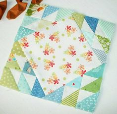 Farmer's Wife 1930s quilt block no. 18 - Carol. Paper-pieced using scraps for the outer and a pretty square for the center.