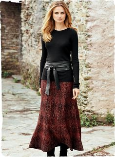 Embroidery from a Siberian textile inspired the scalloped patterning of our flared trumpet skirt. Jacquard knit in madder red, black and plum illuminated with gold metallic threads; pima (80%) and poly (20%).