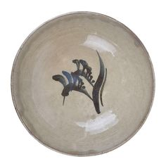 BERNARD LEACH Early Bowl, circa 1935 Stoneware, cream glaze with cobalt blue painted motif in the well, impressed BL and Leach Pottery seals
