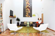 I've never seen terra cotta tile look this cool. contemporary living room by Adam Breaux