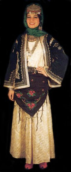 A traditional bridal costume from the city of Mardin (East-Anatolia).  Mid-20th century.  Labeled as 'gelinin günlük kıyafeti' (daily dress for a newly-married girl, which she wears for some weeks after the wedding).