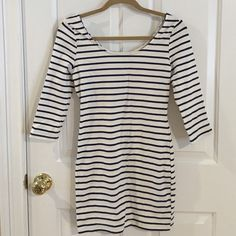 💥GONE TOMORROW💥  Navy and White Bodycon Dress This adorable body con dress with brand new with plastic tag still attached. Never been worn. Dresses Long Sleeve