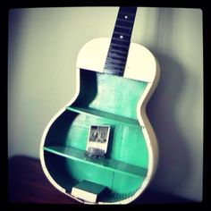 I. Want. This.  Old Guitar turned it shelves!! ♥